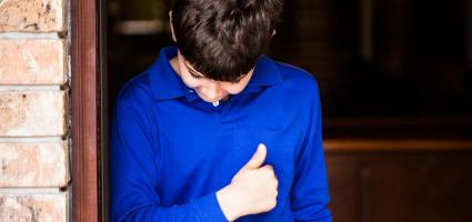 Picture of a boy in a blue shirt