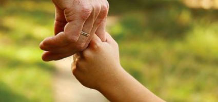 Parent holding the hand of their child