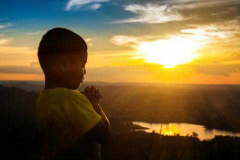 Boy Praying - Sunset