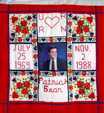 Quilt with a picture of Patrick Sean with his date of birth (July 25 1969) and the date he passed away (November 2nd 1899)