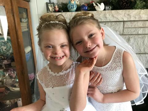 The Reffett sisters in their First Communion dresses