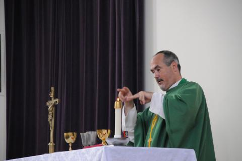 Father Mike Depcik signing Mass during the consecration