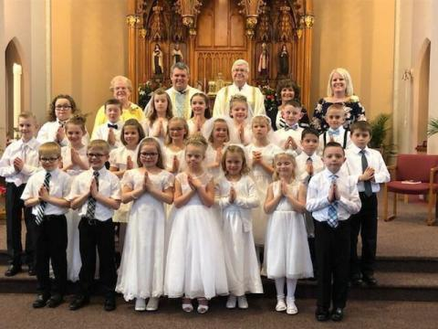 Picture of the Reffett sisters and their fellow classmates on the day of their First Communion