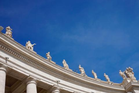 Vatican sculptures of saints with blue sky in the background