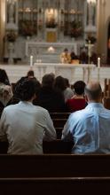 People praying at Mass