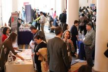 Picture of people networking in an exhibit hall at the Catholic Social Ministry Gathering