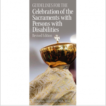 Photo of clergy member holding a Chalice